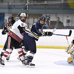 GEORGETOWN, ON  - APR 8,  2018: Ontario Junior Hockey League, South West Conference Championship Series. Game six of the best of seven series between Toronto Patriots and the Georgetown Raiders. Matt McJannet #12 of the Georgetown Raiders battles for control with Lee Lapid #8 of the Toronto Patriots during the third period.<br /> (Photo by Andy Corneau / OJHL Images)