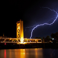 Cloud to ground lightning over the Tower Bridge in Sacramento, California.