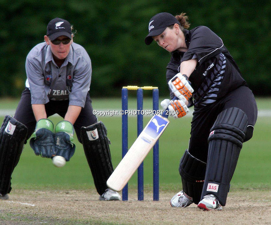 1 March 2006 - New Zealand's Emily Drumm in action as New Zealand 'A' women's wicketkeeper Rowan Miburn looks on during their one day clash at Lincoln University.