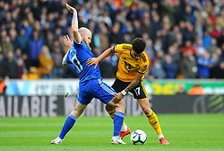 Aron Gunnarsson of Cardiff City competes with Morgan Gibbs-White of Wolverhampton Wanderers  - Mandatory by-line: Nizaam Jones/JMP - 02/03/2019 - FOOTBALL - Molineux - Wolverhampton, England -  Wolverhampton Wanderers v Cardiff City - Premier League
