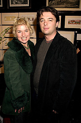 Cabaret star BARONESS ISSY VAN RANDWYCK and her husband MR EDWARD HALL son of Peter Hall, at an exhibition in London on 16th November 2000.OJF 32