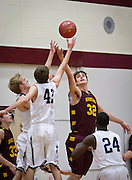 Northfield Raiders forward Luke Harris (32) goes up for a rebound against Rochester Century defenders during the first half of the high school basketball game between Northfield and Rochester Century, Tuesday, December 10, 2013.