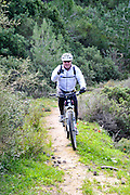Male cyclist in the Carmel forests, Israel