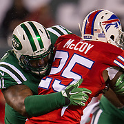 Nov 12, 2015; East Rutherford, NJ, USA;  New York Jets defensive end Sheldon Richardson (91)  tackles Buffalo Bills running back LeSean McCoy (25) in the 1st quarter at MetLife Stadium. Mandatory Credit: William Hauser-USA TODAY Sports
