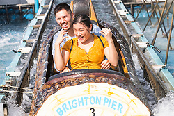 © Licensed to London News Pictures. 13/09/2020. Brighton, UK. Members of the public take a ride on the water attraction on t he Brighton Palace Pier in Brighton And Hove as sunny and warm weather is hitting the seaside resort. Photo credit: Hugo Michiels/LNP