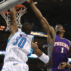 Feb 01, 2010; New Orleans, LA, USA; New Orleans Hornets forward David West (30) dunks over Phoenix Suns forward Amare Stoudemire (1) during the second half at the New Orleans Arena.The Suns defeated the Hornets 109-100. Mandatory Credit: Derick E. Hingle-US PRESSWIRE