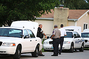 13 September 2010: A member of the Springfield Police Department's Special Response Team (SRT) talks with paramedics prior to taking action on a house with a barricaded subject. SRT would enter the house just after 9 p.m. on Monday, and the subject inside the house gave up with no incident. Credit: David Welker/ Turfimages.com