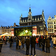 "The Belgian band Opmoc plays on a stage at the Brussels Jazz Marathon in the Grand Place, Brussels. Originally the city's central market place, the Grand-Place is now a UNESCO World Heritage site. Ornate buildings line the square, including guildhalls, the Brussels Town Hall, and the Breadhouse, and seven cobbelstone streets feed into it. In the background, behind the stage, is the Maison du Roi (or Broodhuis / ""Bread House"") which houses the Museum of the City of Brussels."