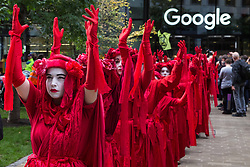 London, UK. 16 October, 2019. Extinction Rebellion's Red Rebel Brigade joins the International Rebellion Autumn Uprising 'No Social Media in a Dead Society' protest outside the headquarters of Google against the US company's role in 'enabling the spread of systematic disinformation on climate change and the ecological crisis'.
