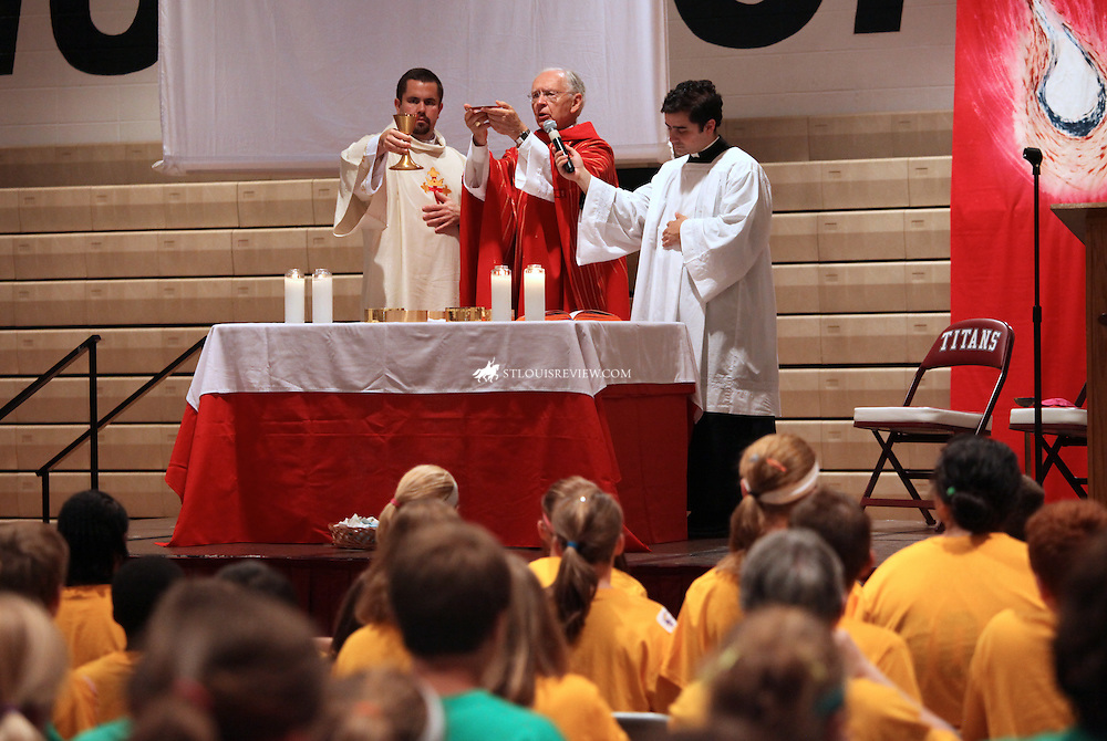 (9-18-09) Bishop Robert Hermann celebrated Mass at the Confirmation Rally for the North Side Deanery at Trinity High School.