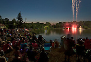Middletown, New York - People watch the fireworks explode over the lake at Fancher-Davidge Park during a Stars and Stripes celebration on June 30, 2012.