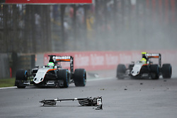 Nico Hulkenberg (GER) Sahara Force India F1 VJM09 and Sergio Perez (MEX) Sahara Force India F1 VJM09 pass debris from the Sauber C35 of Marcus Ericsson (SWE) Sauber F1 Team.<br /> 13.11.2016. Formula 1 World Championship, Rd 20, Brazilian Grand Prix, Sao Paulo, Brazil, Race Day.<br />  <br /> / 131116 / action press