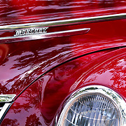 """""""A Tree Grows on Mercury""""<br /> <br /> Amazing candy apple red on a beautiful vintage Mercury. Reflections of light and trees dance of her shiny surface!!<br /> <br /> Cars and their Details by Rachel Cohen"""