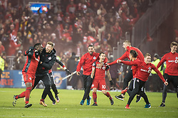 December 9, 2017 - Toronto, Ontario, Canada - Toronto FC forward JOZY ALTIDORE (17) Toronto FC forward SEBASTIAN GIOVINCO (10) and the rest of the team run on the field after the game to celebrate winning the MLS Cup championship match at BMO Field in Toronto, Canada.  Toronto FC defeats Seattle Sounders 2 to 0. (Credit Image: © Mark Smith via ZUMA Wire)