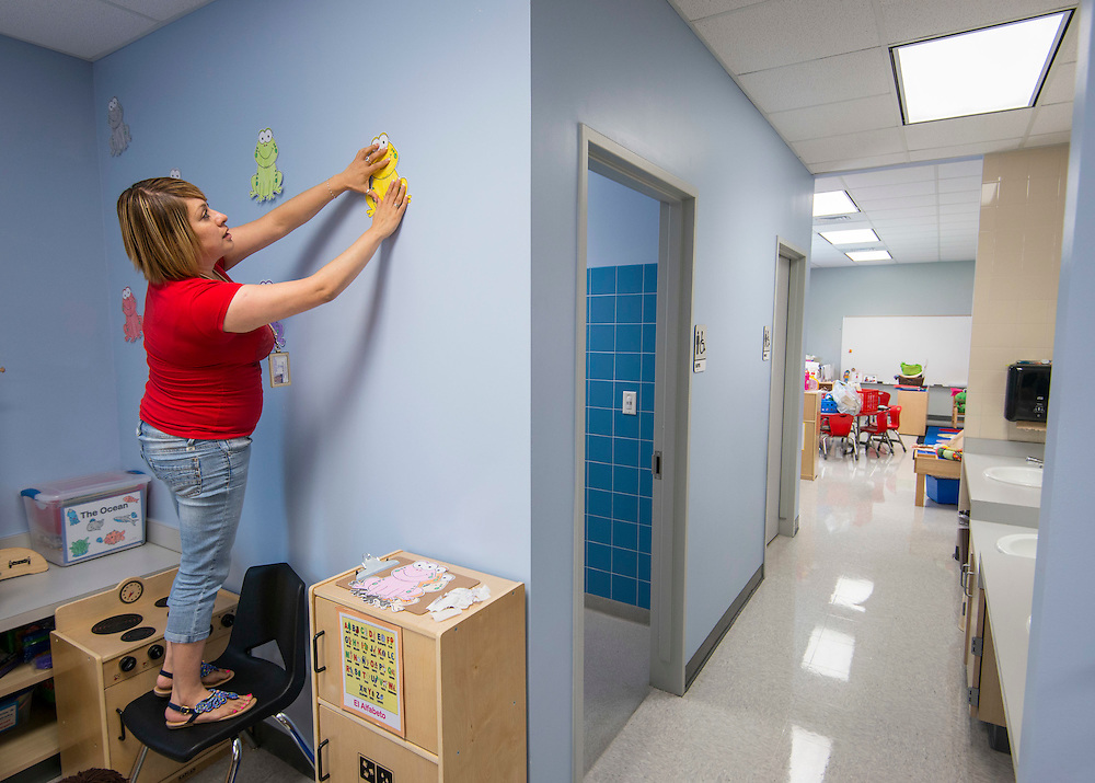 Jaqueline Ortiz prepares her Pre-K tclassroom for the first day of school at Cunningham Elementary School, August 19, 2014.