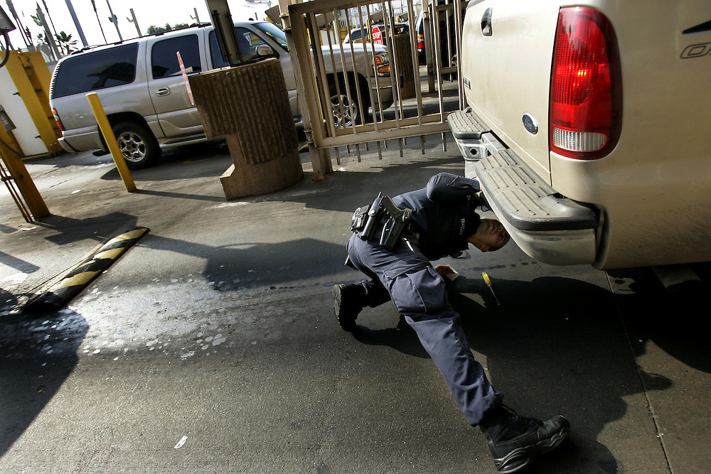 Customs and Border Protection agent Tommy Trassare checks a vehicle for illegal conraband at the U.S. Port of Entry in San Ysidro, Calif.