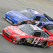 Kevin Conway #7 and Tony Stewart #14 near turn Three at the Sprint Cup race at Dover International Speedway in Dover Delaware. Jimmie Johnson went on to win The Sprint Cup race at Dover International Speedway