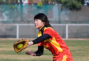 A training session of China's national softball team in Beijing. The team has been coached by several American coaches, and is now under the direction of Michael Bastian of Sacremento, California.