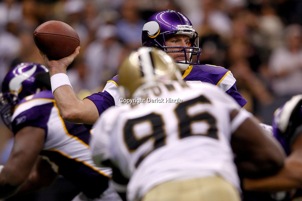 September 9, 2010; New Orleans, LA, USA;  Minnesota Vikings quarterback Brett Favre (4) is pressured by New Orleans Saints defensive end Alex Brown (96) during the NFL Kickoff season opener at the Louisiana Superdome. The New Orleans Saints defeated the Minnesota Vikings 14-9.  Mandatory Credit: Derick E. Hingle