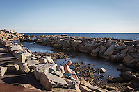 ACCIAROLI (POLLICA), ITALY - 5 OCTOBER 2016: An elderly man relaxes by the sea in Acciaroli, a hamlet in the municipality of Pollica, Italy, on October 5th 2016.<br /> <br /> To understand how people can live longer throughout the world, researchers at University of California, San Diego School of Medicine have teamed up with colleagues at University of Rome La Sapienza to study a group of 300 citizens, all over 100 years old, living in Acciaroli (Pollica), a remote Italian village nestled between the ocean and mountains in Cilento, southern Italy.<br /> <br /> About 1-in-60 of the area's inhabitants are older than 90, according to the researchers. Such a concentration rivals that of other so-called blue zones, like Sardinia and Okinawa, which have unusually large percentages of very old people. In the 2010 census, about 1-in-163 Americans were 90 or older.