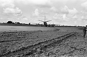 29/03/1963<br /> 03/29/1963<br /> 29 March 1963<br /> B.E.A. Aircrash at Dublin Airport. The crashed BEA Vanguard G-APEJ that carried 43 passengers and seven crew from London to Dublin ploughed its way through half a mile of grassland before returning to the concrete runway, when its front undercarriage appeared to have failed on arrival at Dublin Airport. There were no fatalities in the accident. The path of the aircraft can be seen in the trail of earth across the runway.