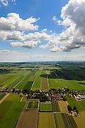 Nederland, Noord-Holland, Beemster, 14-06-2012; De Beemster, 400 jaar 1612 - 2012. Het dorp Westbeemster, IJsselmeer aan de horizon (foto naar het oosten). De 17e eeuwse droogmakerij, met haar  beroemde geometrische verkaveling, maakt deel uit van het wereld erfgoed (Unesco werelderfgoedlijst).The famous geometrical well-ordered polder Beemster, 17th century  reclaimed landscape, Unesco world heritage..luchtfoto (toeslag), aerial photo (additional fee required);.copyright foto/photo Siebe Swart