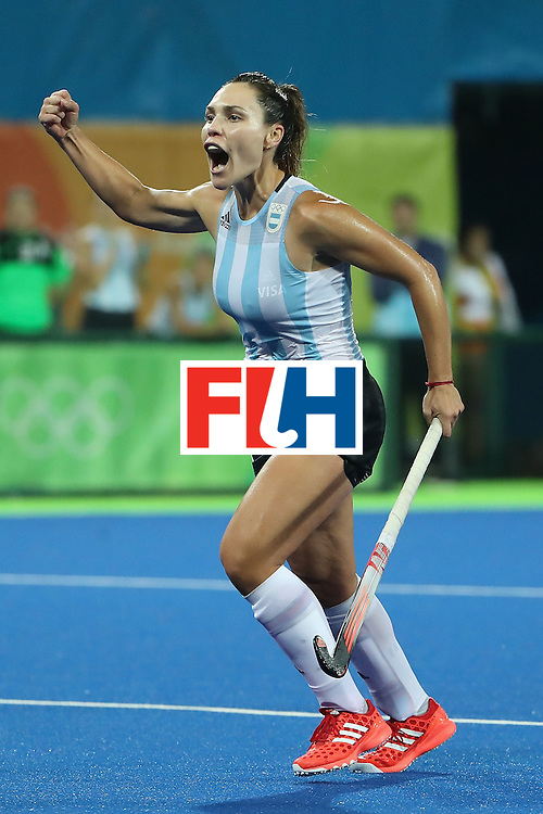 RIO DE JANEIRO, BRAZIL - AUGUST 15:  Rocio Sanchez #17 of Argentina celebrates after Florencia Habif (not pictured) scored a goal against Netherlands during the quarter final hockey game on Day 10 of the Rio 2016 Olympic Games at the Olympic Hockey Centre on August 15, 2016 in Rio de Janeiro, Brazil.  (Photo by Christian Petersen/Getty Images)
