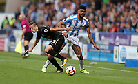 Football - 2017 / 2018 Premier League - Huddersfield Town vs. Newcastle United<br /> <br /> Philip Billing of Huddersfield Town and Javi Manquillo of Newcastle United at The John Smith Stadium.<br /> <br /> COLORSPORT/LYNNE CAMERON