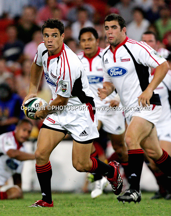 Crusaders five eighth Dan Carter in action during the 2006 Super 14 rugby union match between the Reds and the Crusaders at Suncorp Stadium, Brisbane, Australia, on Saturday 18 February, 2006. The Crusaders defeated the Reds 47-21. Photo: PHOTOSPORT<br />