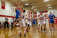 Inter Lakes' Thomas DeTolla goes up for a shot guarded by Laconia's Ryan Dee during NHIAA Division III basketball Tuesday evening.  (Karen Bobotas/for the Laconia Daily Sun)