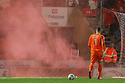 A flare is thrown towards the pitch during the EFL Sky Bet League 1 match between Doncaster Rovers and Bradford City at the Keepmoat Stadium, Doncaster, England on 19 March 2018. Picture by Aaron  Lupton.
