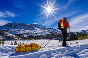 Backcountry skier towing a sled, John Muir Wilderness, Sierra Nevada Mountains, California USA