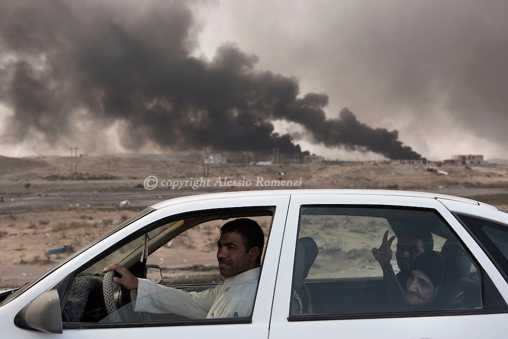 Iraq, Qayyara: On October 2016, internal displaced are seen as they approach Qayyara northern check point south of Mosul. Alessio Romenzi