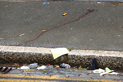 © Licensed to London News Pictures. 14/07/2019. London, UK. Personal effects and a blood stain remain on the pavement near Lombard Road in Battersea, south west London after a car was driven into a group of people leaving a hotel. Three men have been arrested on suspicion of murder after the incident which took place at 11. 15pm on Saturday night. One man has a broken leg and six other people also sustained minor injuries. Photo credit: Peter Macdiarmid/LNP