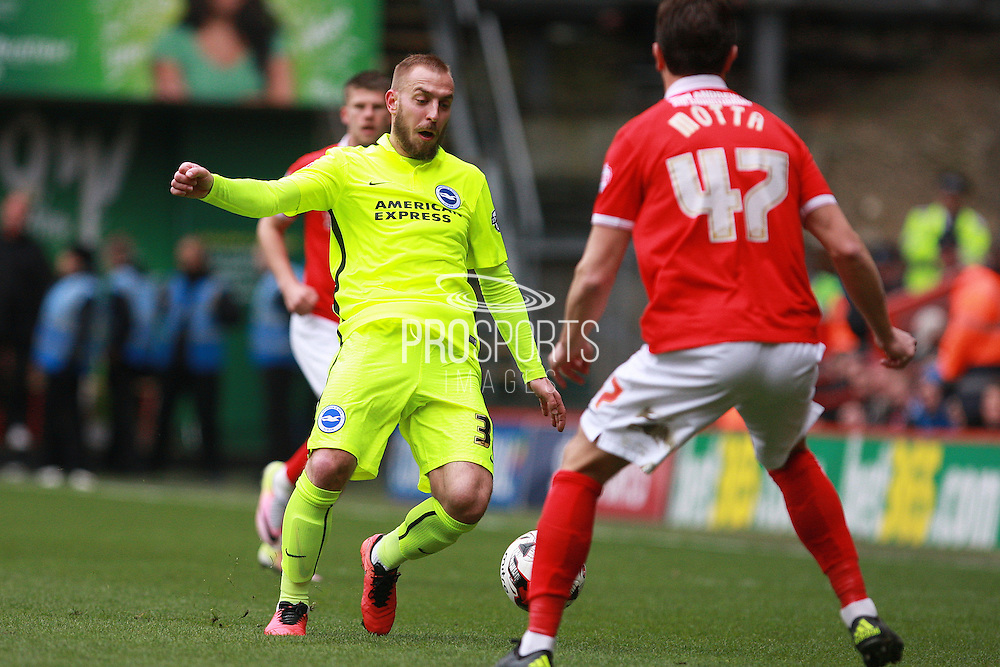 Brighton striker Jiri Skalak takes on Charlton Athletic defender Marco Motta during the Sky Bet Championship match between Charlton Athletic and Brighton and Hove Albion at The Valley, London, England on 23 April 2016. Photo by Bennett Dean.