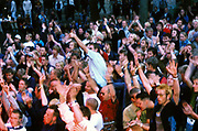 Large crowd of people with arms in the air, clapping and dancing, Quart festival, Kristiansands Norway 2000