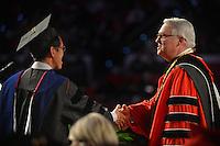 Chancellor Randy Woodson (right) congratulates a graduate student for his achievement.