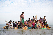 Sunday 12th November 2017. After 16 - 20 days waiting on the Myanmar border, Rohingya refugees cross the Naf River into Bangladesh using eight makeshift rafts made out of bamboo and plastic palm oil containers. <br /> <br /> Often described as the &quot;world's most persecuted minority&quot;, the Rohingya are a Muslim ethnic group from the Rakhine State in Myanmar. In October 2016, a military crackdown in the wake of a deadly attack on an army post sent hundreds of thousands of Rohingya fleeing to neighboring Bangladesh. <br /> <br /> This most recent exodus from Rakhine state, Myanmar, to the makeshift camps that have sprung up in Cox&rsquo;s Bazar District, began August 25, 2017, when militants from the Arakan Rohingya Salvation Army targeted about 30 police posts and an army base, killing several people. <br /> <br /> So far more than 650,000 people have fled into Bangladesh, swelling the camps and creating a humanitarian crisis. Photograph by David Dare Parker