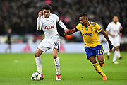 Dele Alli (20) of Tottenham Hotspur battles for possession with Alex Sandro (12) of Juventus during the Champions League match between Tottenham Hotspur and Juventus FC at Wembley Stadium, London, England on 7 March 2018. Picture by Graham Hunt.