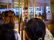09 NOVEMBER 2018 - BANGKOK, THAILAND: A security guard talks to shoppers trying to get into ICONSIAM before the grand opening. ICONSIAM opened November 9. ICONSIAM is a mixed-use development on the Thonburi side of the Chao Phraya River. It includes two large malls, with more than 520,000 square meters of retail space, an amusement park, two residential towers and a riverside park. It is the first large scale high end development on the Thonburi side of the river and will feature the first Apple Store in Thailand and the first Takashimaya department store in Thailand.    PHOTO BY JACK KURTZ