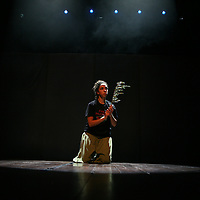 "A Palestinian Circus School member holds a branch of an olive tree as a symbole to peace, during the show ""Circus behind the wall"" in Ramallah, November 20, 2009. The circus group was established in 2006, in order to give a new way of expression for Palestinians, and a new way to deliver the idea of resistance to the occupation. This performance shows the life of Palestinians behind the separation wall. Photo by Michal Fattal/Backyard"