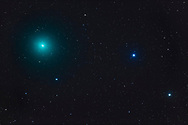 Comet Wirtanen 46P at perihelion (at its closest to the Sun) in a telescopic close-up on December 12, 2018. It was then near the stars Xi (centre right) and Omicron (bottom right) Tauri. There is no sign of a tail in this image, though it was taken through some thin cloud. <br /> <br /> This is with the 106mm aperture Astro-Physics Traveler for a field roughly 3.3 x 2.2 degrees at f/5.8 with the 6x7 field flattener. This is a stack of 2 x 4-minute exposures aligned on the stars and 2 x 1-minute exposures aligned on the comet for the starlike core. All with the Canon 6D MkII at ISO 1600. Taken from home.