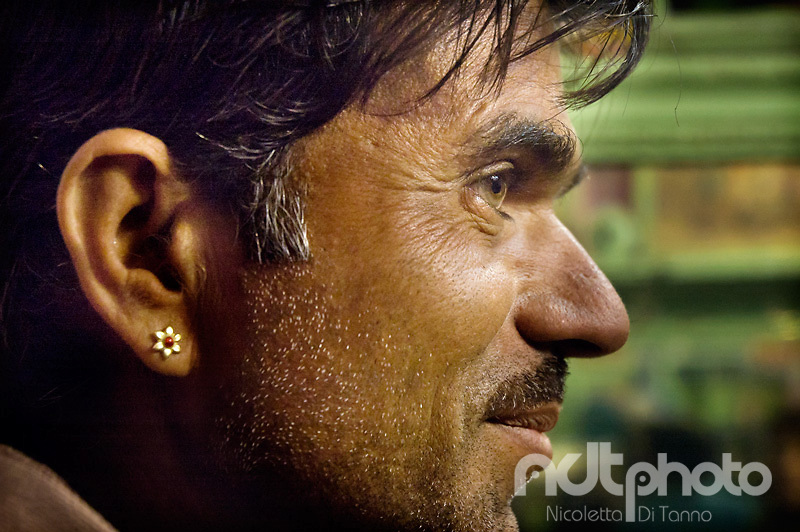 Portrait of a man with flower-shaped earring. Rajasthan, India