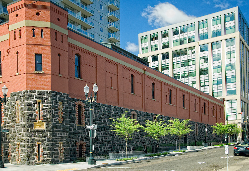 The First Regiment Armory Annex, commonly known as the Portland Armory Building, at 128 NW 11th Avenue.  The building was renovated from 2002 to 2006 (to LEED Platinum certification) and now houses the Gerding Theater, used primarily by the theatre group Portland Center Stage.   The adjacent Vera Katz Sidewalk Park, or Sliver Park, includes a bioswale for stormwater treatment and a water channel of sculpted black basalt.  The water feature design, by Scott Murase of landscape architect firm Murase Associates, is part of the building's storm water management and is fed by roof runoff.