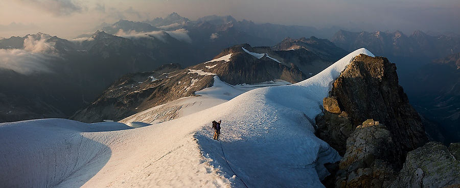 Jim Prager descends a snow ridge below the summit of Mount Challenger, Picket Range, North Cascades National Park, Washington.