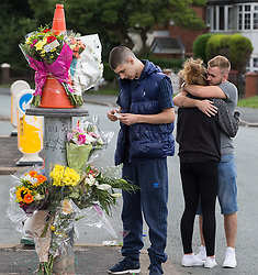 © Licensed to London News Pictures . 15/08/2015 . Manchester , UK . People leave flowers and tributes at the scene on Lightbowne Road , Moston in Manchester where a man died following a fatal road accident in the early hours of this morning (Saturday 15th August 2015) . Police report a green Rover 25 collided with a lamppost and a passenger , believed to be 21 years old , was pronounced dead at the scene . An 18 year old passenger is in hospital with life-threatening injuries and the 19 year old driver is also in hospital , in a serious but stable condition . Photo credit : Joel Goodman/LNP