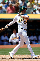 OAKLAND, CA - JULY 28:  Matt Olson #28 of the Oakland Athletics hits a double against the Texas Rangers during the third inning at the RingCentral Coliseum on July 28, 2019 in Oakland, California. (Photo by Jason O. Watson/Getty Images) *** Local Caption *** Matt Olson