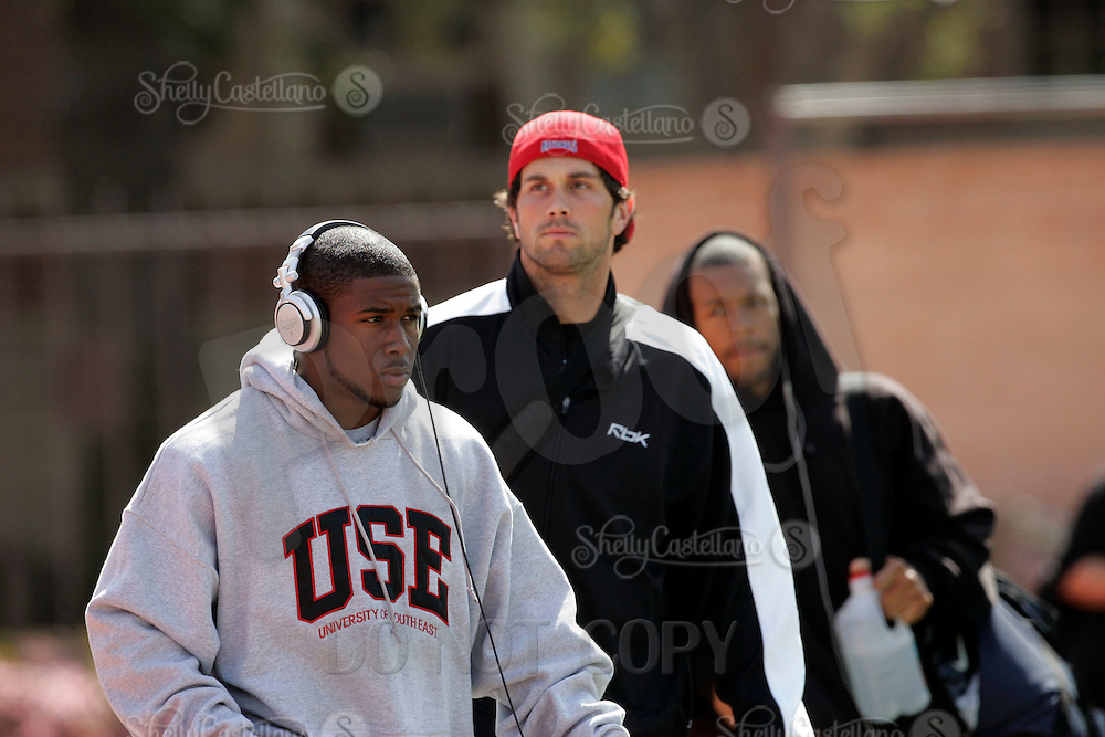 2 April 2006: Heisman winner Reggie Bush listening to Sony Music arrives with quarterback Matt Leinart and Darnell Bing at pro-day timing workout by pro football teams at NFL pro-timing day at USC college campus in Los Angeles, CA.