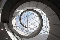 """I had access """"behind the curtain"""" of The Dali Museum in St. Petersburg, Florida and left with a personal favorite photograph. This view shows the spiral character of Weymouth's design, a perspective that can only be achieved from the floor behind the ticket counter."""