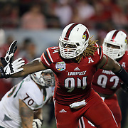 Louisville Cardinals defensive end Lorenzo Mauldin (94) is seen during the NCAA Football Russell Athletic Bowl football game between the Louisville Cardinals and the Miami Hurricanes, at the Florida Citrus Bowl on Saturday, December 28, 2013 in Orlando, Florida. Louisville won the game by a score of 36-9. (AP Photo/Alex Menendez)